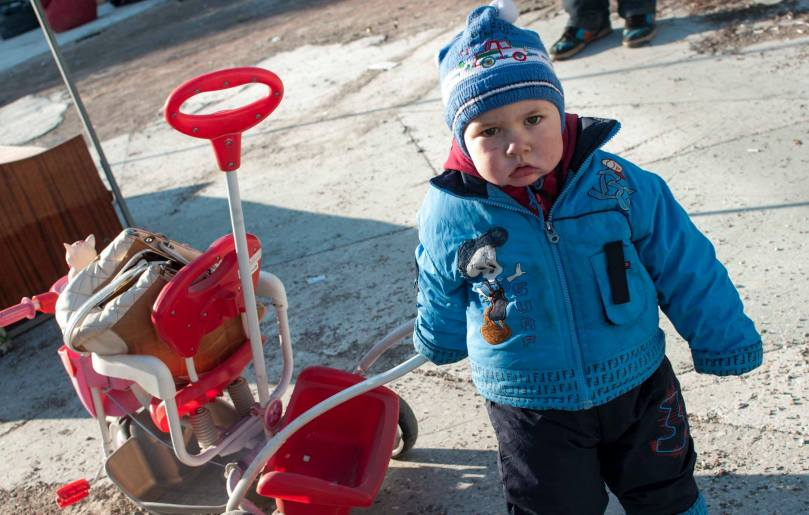 Maksim, who is a year and a half old, is from Donetsk, photographed in Kiev with his new toy. |Photo: Simone Peek